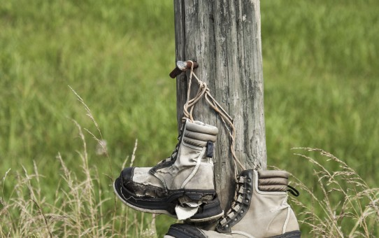 Hiking boots on post Parham P Baker Photography